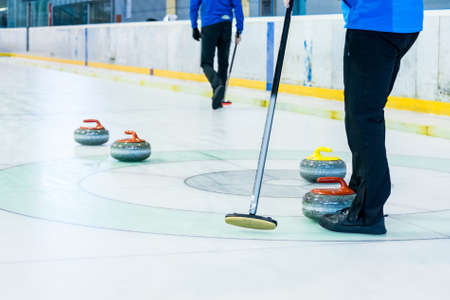 skill: Playing a game of curling.