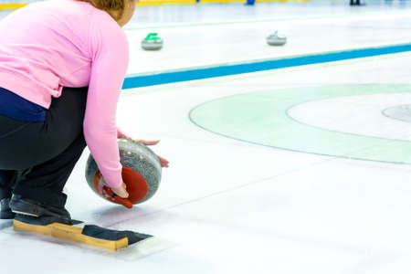 Playing a game of curling.