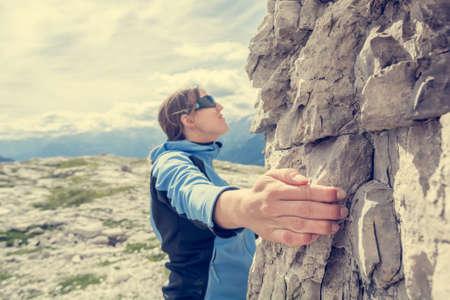 Attractive brunette rock climbing. Stock Photo