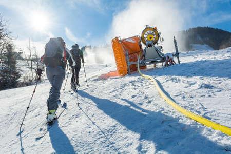 ski walking: Ski resort with snow gun making new surface.