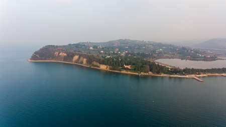 Aerial view of cliffs raising above sea.