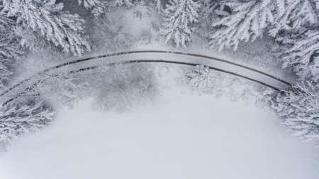 Aerial view of snow covered forest meadow. Standard-Bild