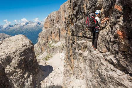 Female climber on via ferrata route.