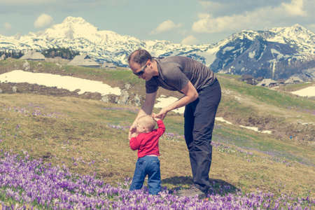Father teaching his daughter how to walk in nature. Stock Photo