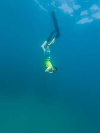 Male diver swimming in ocean enjoying summer.
