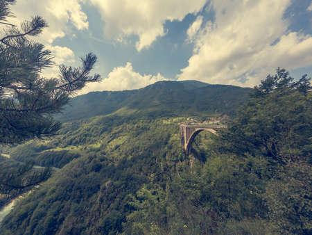 Concrete arch bridge crossing a deep valley. Djurdjevica Tara bridge in Montenegro.