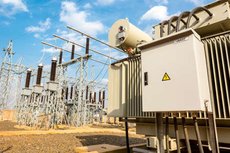Power utility box on a power transformer in substation switchyard. Banco de Imagens - 112398235