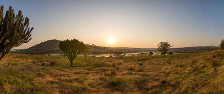 Spectacular savannah landscape of sun raising above marshes.