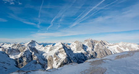 Spectacular winter mountain panorama with peaks covered with early snow.