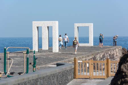 Garachico, Spain - February 6: Tourist exploring Window sea famous frame structure, on February 6 2019 in Garachico, Spain