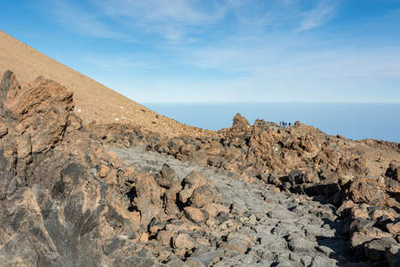 Hiking trail running through spectacular volcanic landscape.