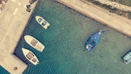 Drop down view of fishing port with boats tied in. Savar, Dugi otok.