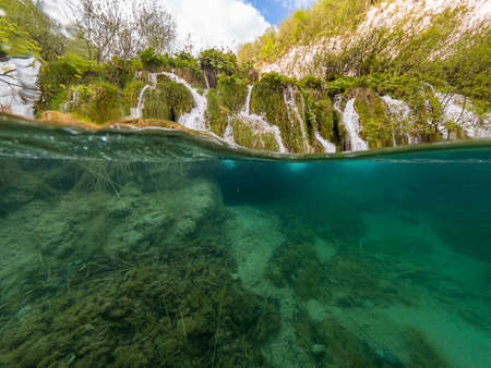 Amazing split view of waterfalls falling into lake. 版權商用圖片