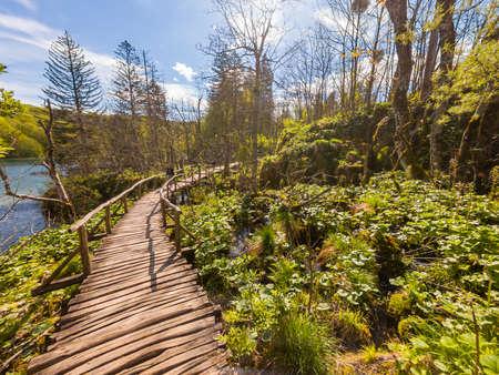 Wooden boardwlak passing waterfalls in natural park. Plitvice, Croatia.