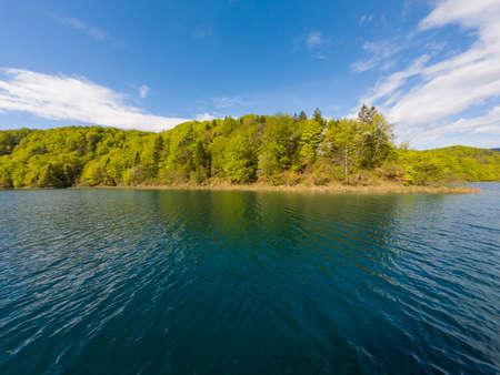 Spectacular lake shore panorama of green forest. Plitvice national park, Croatia. 版權商用圖片