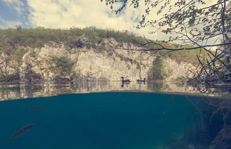 Amazing split view of waterfalls falling into lake. Plitvice national park, Croatia. 版權商用圖片