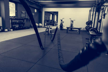 Battle rope training in gym - first person point of view. Imagens