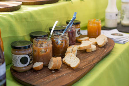 Various marmelades and spreads prepared for outdoor breakfast.