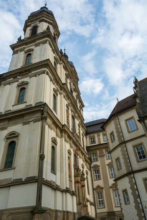 Picturesque baroque abbey church facade with many details.