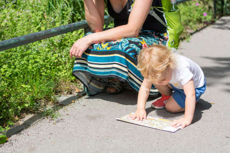 Mother and daughter looking at a map and planning which way to take.