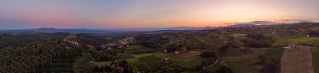 Aerial panorama of wine region countryside at sunset. Banco de Imagens