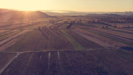 Aerial view of autumn fields at sunset. Banco de Imagens
