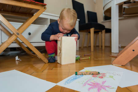 Children playroom with drawing and varios pens lying on the floor. Supporting creativity.