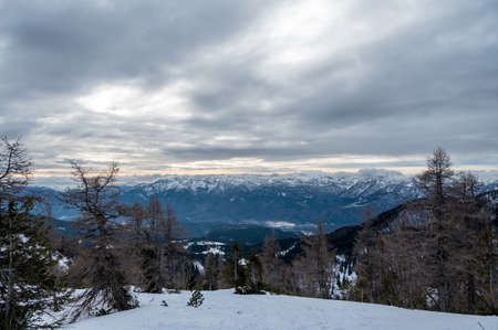 Spectacular winter mountain panoramic view of mountains with clouded sky. Stock fotó