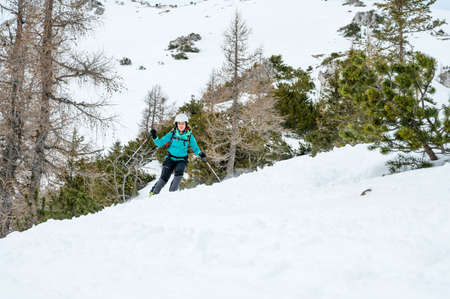 Female skiier enjoying back country skiing in the mountains. Stock fotó