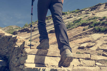 Low angle view of hikin boots ascending steps.