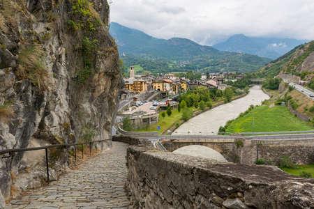 Stone paved path descending into old italian mountain town. Stok Fotoğraf