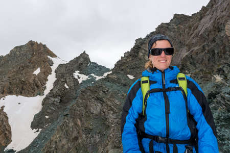 Portrait of female mountaineer posing in the mountains.