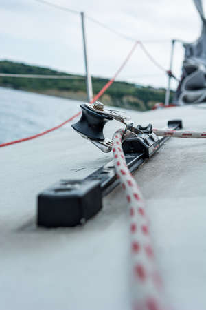 Hand winch on a sailboat while sailing. Detail of sail equipment.