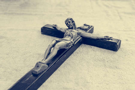 Hand size crucifix - Jesus on wooden cross relic.