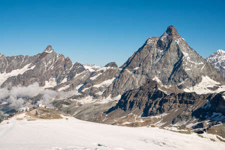 Spectacular mountain view with Matterhorn raising above ski resort during summer. 写真素材