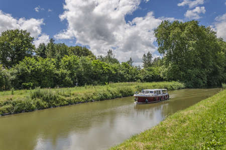 upstream: Boat traveling upstream the canal, Burgundy, France