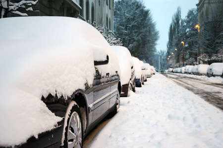 8 12: Cars cowered with thick layer of snow in the early morning, Ljubljana  8 12 2012 , Slovenia  Stock Photo