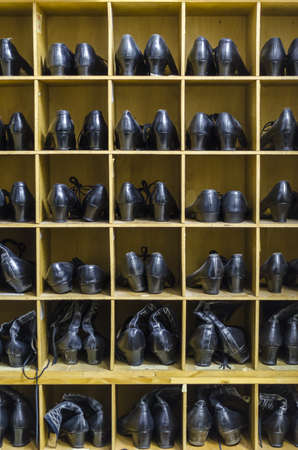 organised: Old folkloristic dancing boots organised in trays. Stock Photo