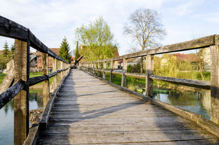 Old wooden bridge for pedestrians in Kostanjevica na Krki, Slovenia, Europe  photo