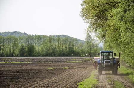 mechanization: Farmer checking mechanization before planting corn seeds