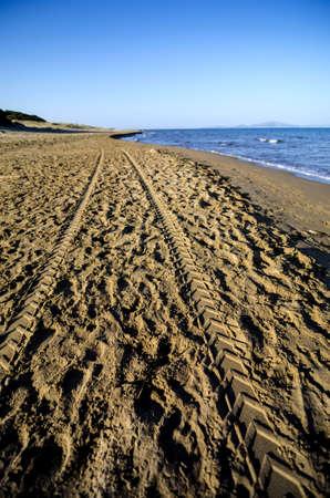 four wheel drive: Quad bike tyre tracks on a sandy beach in Greece