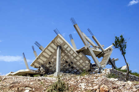 insufficient: Collapsed construction because of bad construction planning with insufficient reinforcements, Ksamil, Albania  Stock Photo