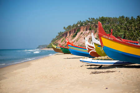 Colorful fishing boats on beach in Varkala, Kerala, India.  photo