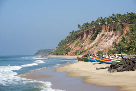 Tropical beach with fishing boats near Varkala, Kerala, India. photo