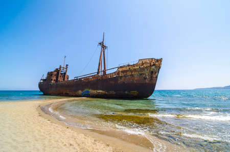 wheelhouse: Abandoned and rusty shipwreck near Gytheio, Greece