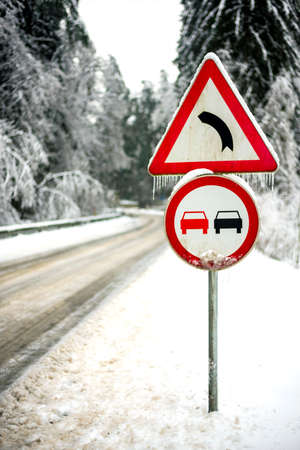 Warning road sign in icy winter conditions. photo