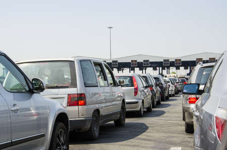 causing: Toll collecting causing massive traffic congestion during rush hours.