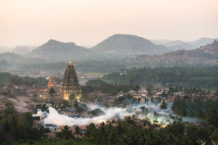 Fogging the mosquitoes away after the sunset, Hampi, India. photo
