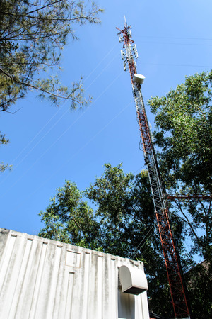 metal structure: High mast metal structure telecommunication on tower with blue sky. Stock Photo