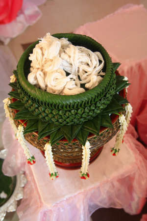 rite: White thread in banana leaf art handwork basket thai rite style
